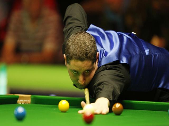 Stuart Carrington beat Mark Williams to reach the Crucible