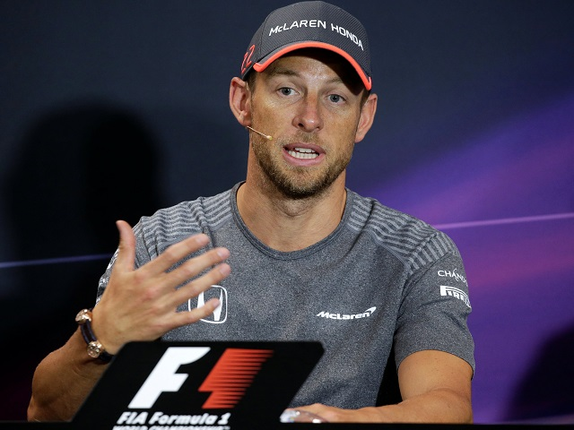 Jenson Button talks through his return at a Monaco news conference