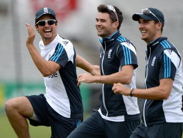 All smiles: Cook, Anderson and Finn train at Old Trafford
