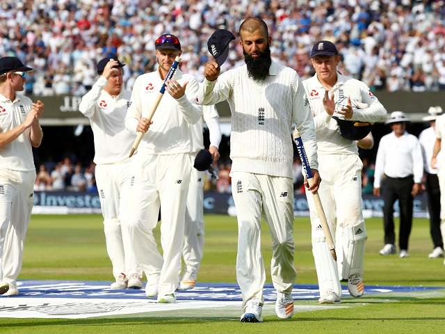 England's players applaud match winner Moeen Ali after victory at Lord's