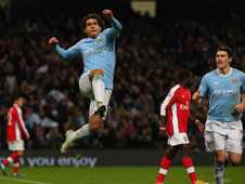Carlos Tevez will face off against his former team-mates in the Carling Cup semi-final