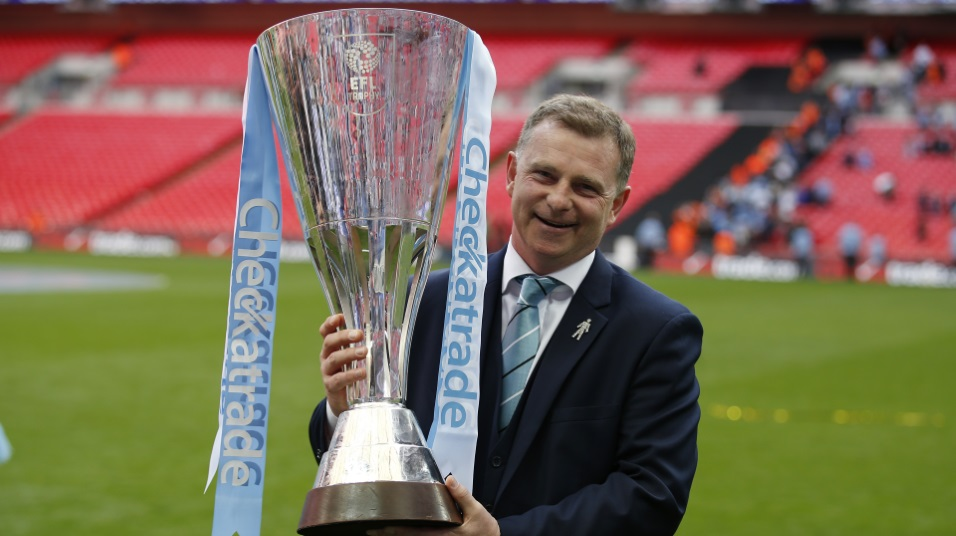 Mark Robins celebrates winning the Checkatrade Trophy with Coventry City in April