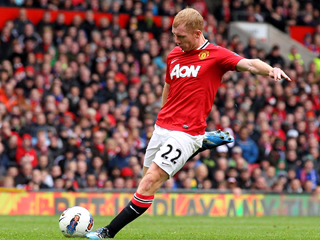 Paul Scholes netted Man United's second against ten-man QPR