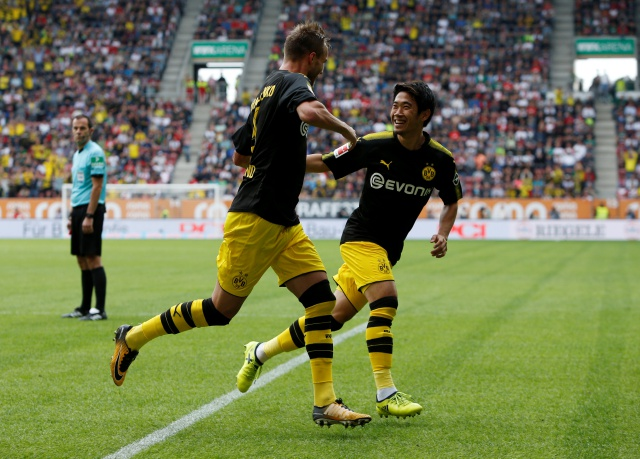 Andriy Yarmolenko and Shinji Kagawa celebrate the former's opener at Augsburg on Saturday