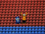 Wigan and Hull mascots stand side-by-side in an empty stand at the BW Stadium in Wigan, a sign that the FA Cup is very much playing second fiddle to the Premier League