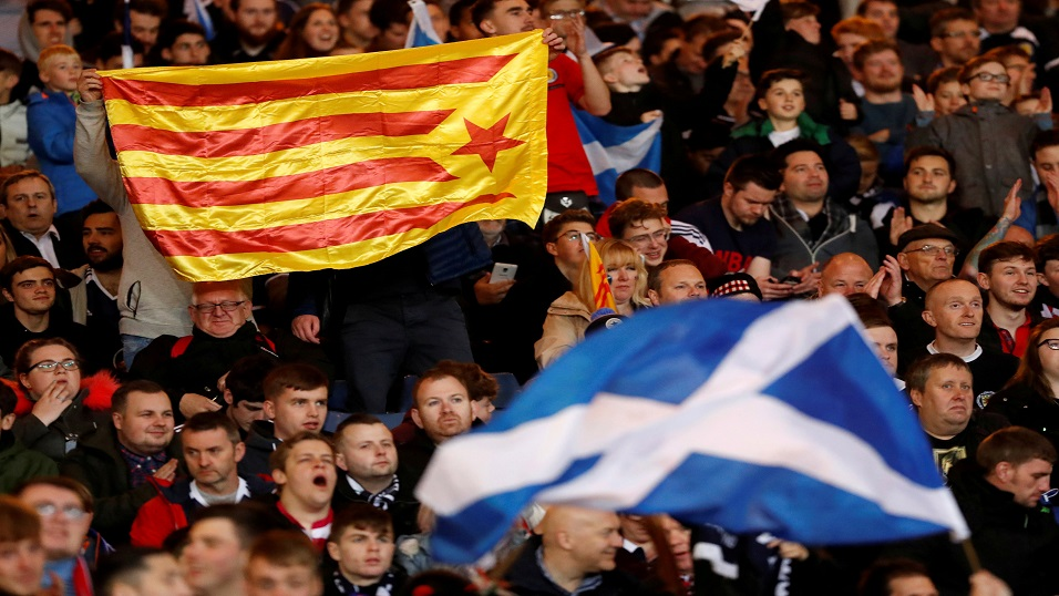 Scotland fans wave a Catalan flag at a football match