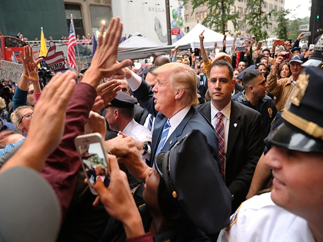As his party distances itself, the GOP nominee was mobbed by supporters outside Trump Tower