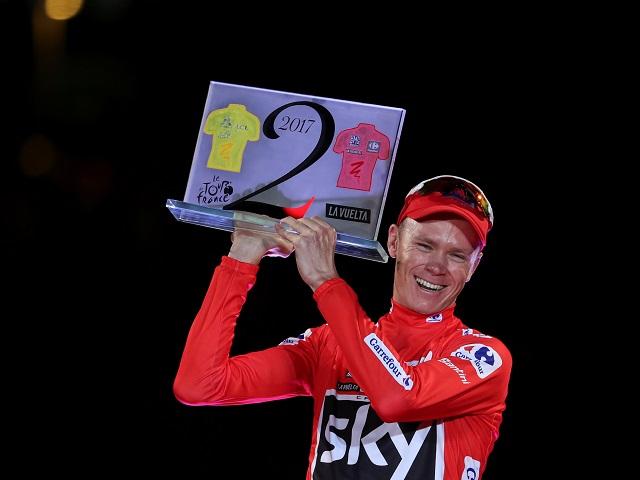 History maker - Chris Froome celebrates his unique double Tour triumph