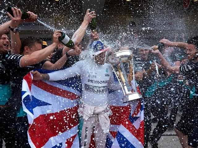 Champagne lifestyle... Lewis Hamilton celebrates his world title with his Mercedes crew
