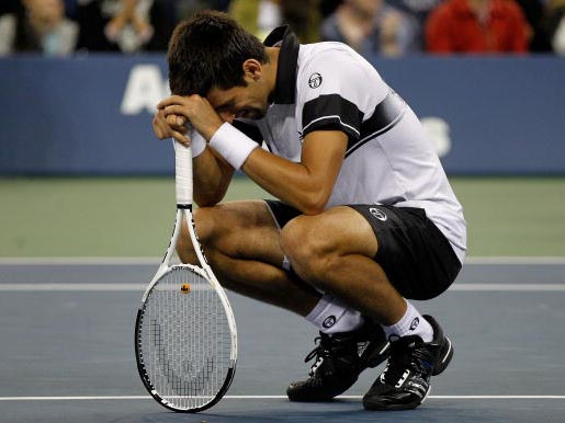 An exhausted and disconsolate Novak Djokovic after his defeat to Nadal in the US Open final