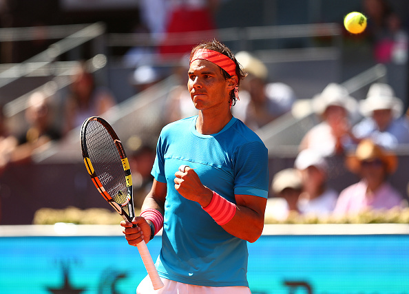 Rafa Nadal can celebrate victory over Milos Raonic on Wednesday...