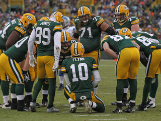 Back up quarterback Matt Flynn calls the plays against the Detroit Lions as Green Bay rounded out the season with a win